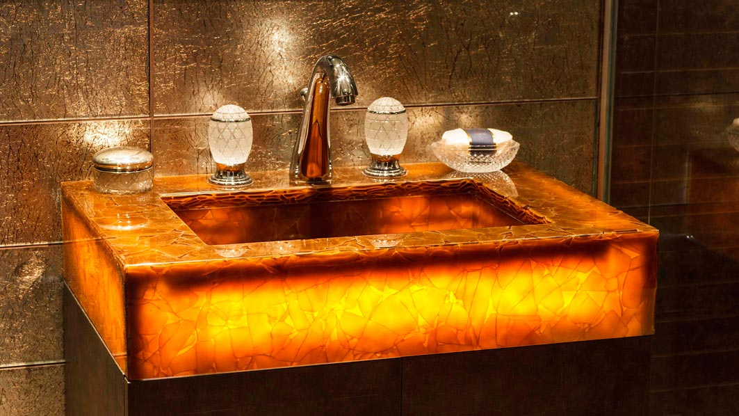 interesting basin complimented by glass basin taps