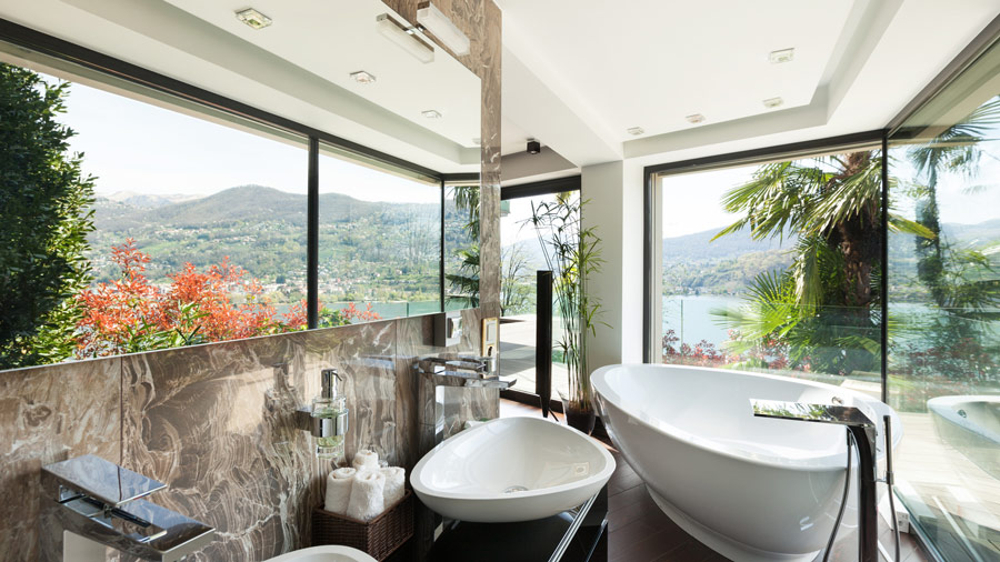 bathroom featuring a lot of glass which is ideal for a glass waterfall basin mixer