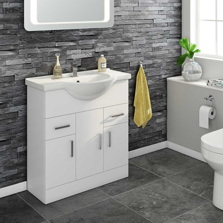 A white floor standing vanity unit and basin