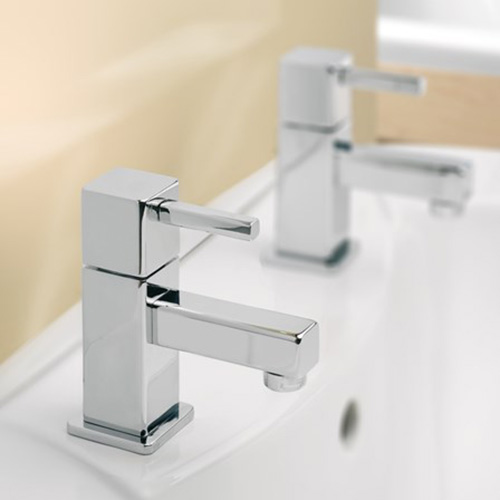 A pair of square contemporary bath taps