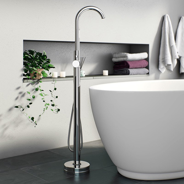 A freestanding bath shower mixer over a freestanding bath