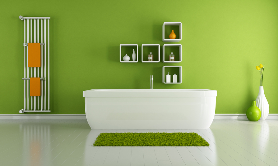 A green bathroom with orange towels