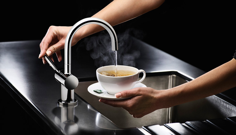 Hot filtered water kitchen mixer pouring an instant cup of tea