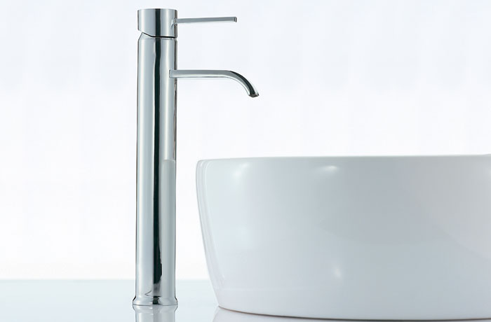A tall basin mixer tap paired with a white ceramic basin