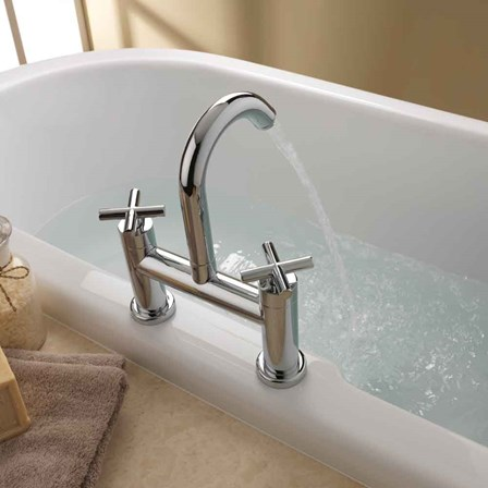 A deck mounted bath filler with crossed controls for extra style