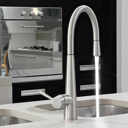 A high-tech led kitchen tap with a celestial white water flow.